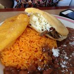 L-R: Chicken empanada, yellow rice, beef arepa, beans.