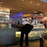sushi chefs enjoying their work.,
