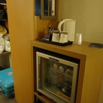 The mini bar and safe below that