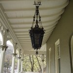 Old time lighting fixture on front porch of Asa Packer Mansion