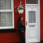 Photo of Jackie at George Harrison's childhood home