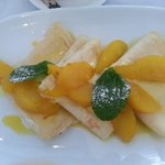 Light Crepes with pear poached in saffron & lemon syrup