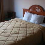 Comfortable bed, but old style bedding.