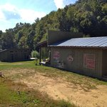 View of the back of the campstore and the front of the bathhouse as we walked out of the woods