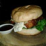 Fish burger with cheddar, tartar and bbq sauce