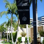 Front of hotel with banner.