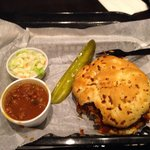 Sweet pulled pork sandwich, baked beans, cole slaw and a pickle. Excellent!