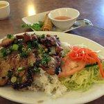 Marinated pork chop and lemon grass chicken on rice