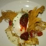 Tintenfisch mit Tomaten Confit und pochiertem Ei