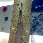 Shower heads adorn the walls