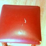this is the kitchen stool with cracked torn seat