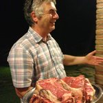 Renzo showing us the steaks before being cooked over wood fire