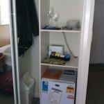 small bar fridge inside the wardrobe