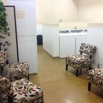 Laundromat with waiting area, free book exchange 14 of each washers & dryers.