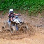 RIding ATV's (I am so muddy)
