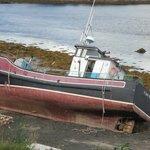 Abandoned fishing boat near room