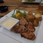 Pork sirloin, mashroom sauce, baked potatoes, rocket salad