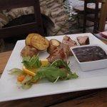 Pork sirloin, plum sauce, baked potatoes, rocket salad