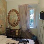 Tiny room, peeling wallpaper