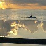 sunrise reflcting on the infinity pool