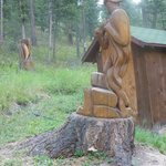 Carving of fisherman next to cabin