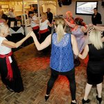 Joining in the traditional Greek dancing