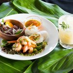 Appetizer Trio featuring shrimp and ahi poke and fresh spring vegetable rolls