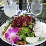 The lovely harvest salad with chicken salad and an edible flower
