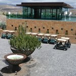 Hotel concourse, golf buggies and glass function room above