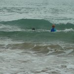 boys trying out some waves, early morning tide coming in around 7.30am