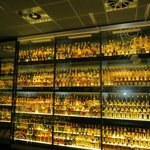 A room filled with bottles of whiskey