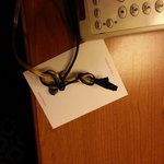 Our light cord spliced an rewired held by electrical tape. Fire hazard!