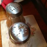 Conjealed food on the salt pot