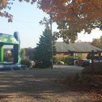 Bouncy house, parking lot, porta potty and wine tasting house