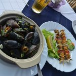 Two kind of dishes with mussels