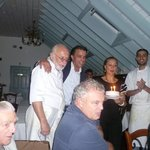 Kamillo and staff present the Birthday cake