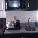 Microwave and sink in the suite.