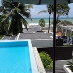 View of pool, ocean and construction site from balcony