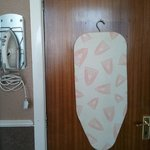 iron/ironing board in room