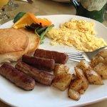 scrambled eggs, sausage, American fries