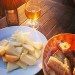 Pear, aged cheese and honey served with bread. And a beer.