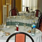 Uncleared tables at breakfast