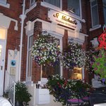 Our lovely hanging baskets at dusk