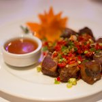 Chilli ribs - Short cut tender pork ribs stir-fried with scallion and chill.