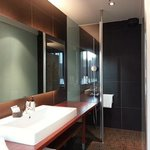 Bathroom with faux leather walls in the shower.