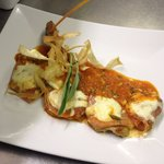 Saltimbocca alla Romana,veal escalopes topped with Parma ham and mozzarella in a tomato caper an