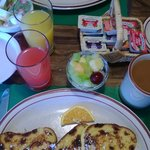 Raisin bread French toast with fresh fruit cup and pancakes stuffed with fresh strawberries.