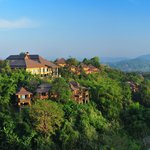 Surrounded by verdant forests and nestled within the mist-shrouded hills of northern Thailand.