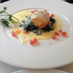 Crumbed	fried	egg with spinach and Taleggio cheese sauce