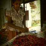 The grandmother peeling the dried chillies